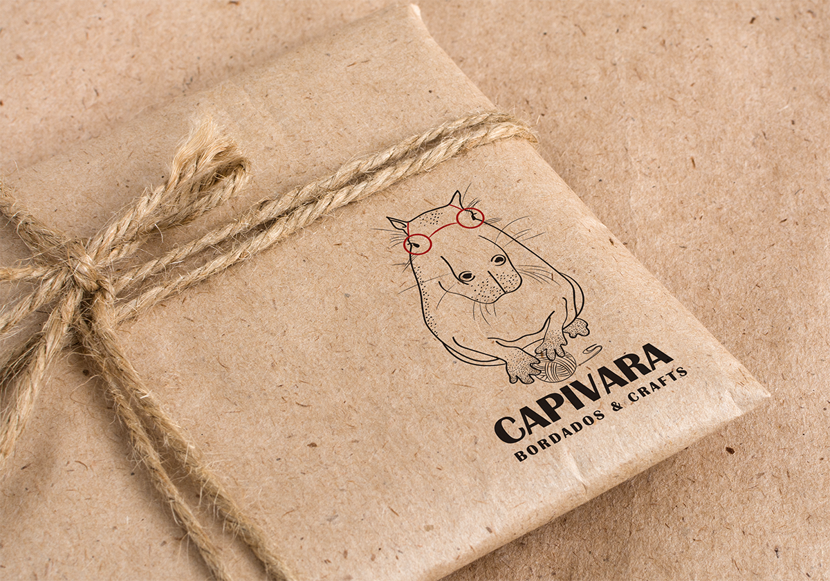 capivara logo stamped in a craft package